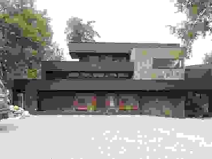 casa en Lago Calafquen Chile Casas de estilo rústico de David y Letelier Estudio de Arquitectura Ltda. Rústico