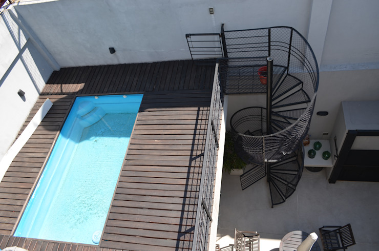 Pileta en primer piso. Terraza accesible. de NG Estudio Moderno Madera Acabado en madera
