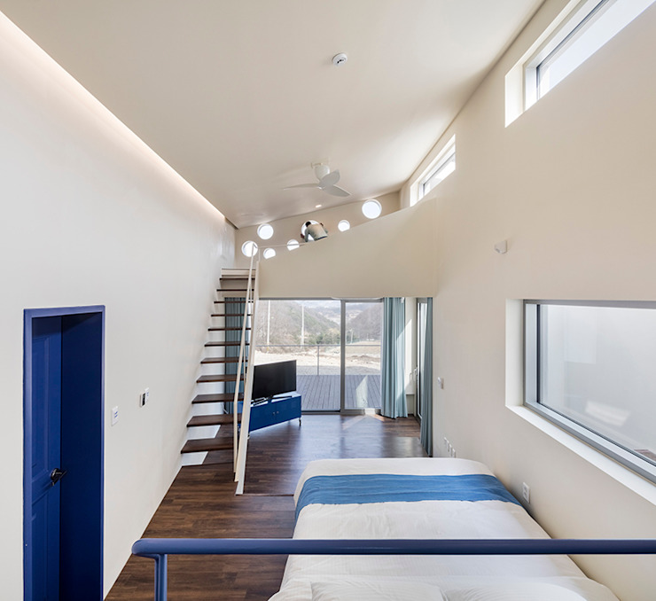 Salas modernas de HGA 건축디자인연구소 Moderno Madera Acabado en madera
