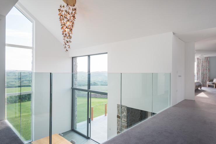 Contemporary Replacement Dwelling, Cubert:  Corridor, hallway & stairs by Laurence Associates,