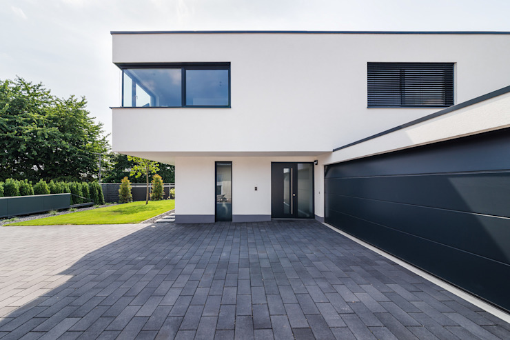 Casas de estilo  de Helwig Haus und Raum Planungs GmbH, Moderno