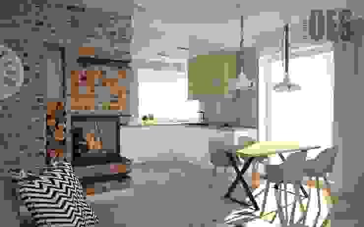 Cegła i beton w salonie OES architekci Nowoczesna kuchnia Kamień Biały