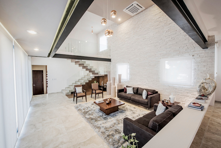Salas de estilo  por Constructora e Inmobiliaria Catarsis, Moderno Piedra