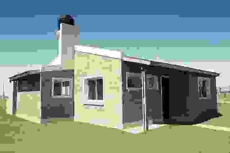 Punta Chacra Roldan Casas rústicas de Arq. Gustavo Piazza & Asociados Rústico