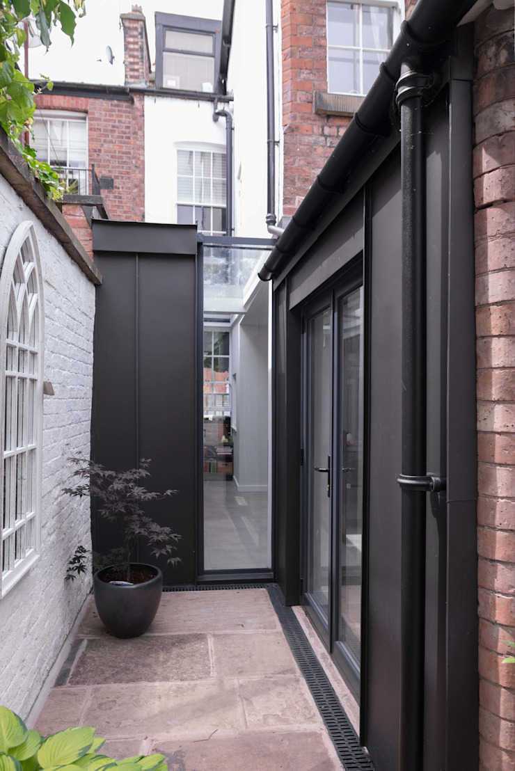 Side infill extension guy taylor associates Casas de estilo moderno