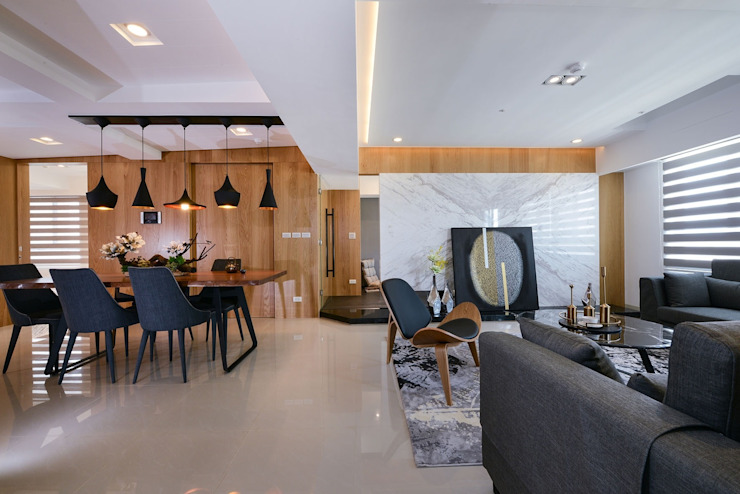 客廳與餐廳 现代客厅設計點子、靈感 & 圖片 根據 見本設計 現代風
