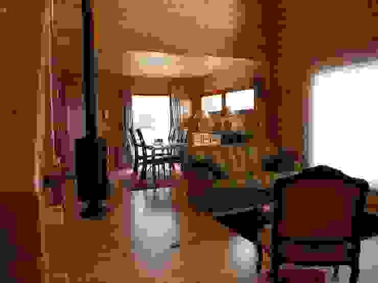 Salas de estar modernas por homify Moderno Madeira Acabamento em madeira