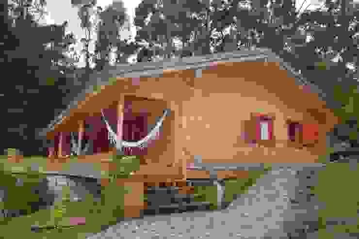Chalés e casas de madeira  por homify