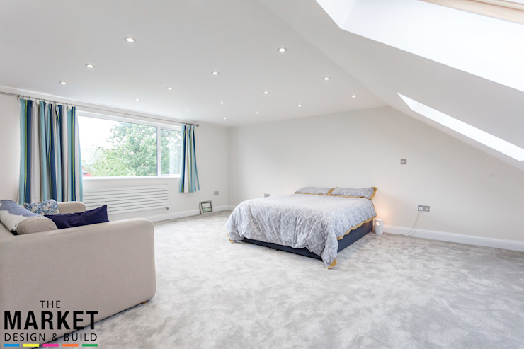 STUNNING NORTH LONDON HOME EXTENSION AND LOFT CONVERSION:  Bedroom by The Market Design & Build,