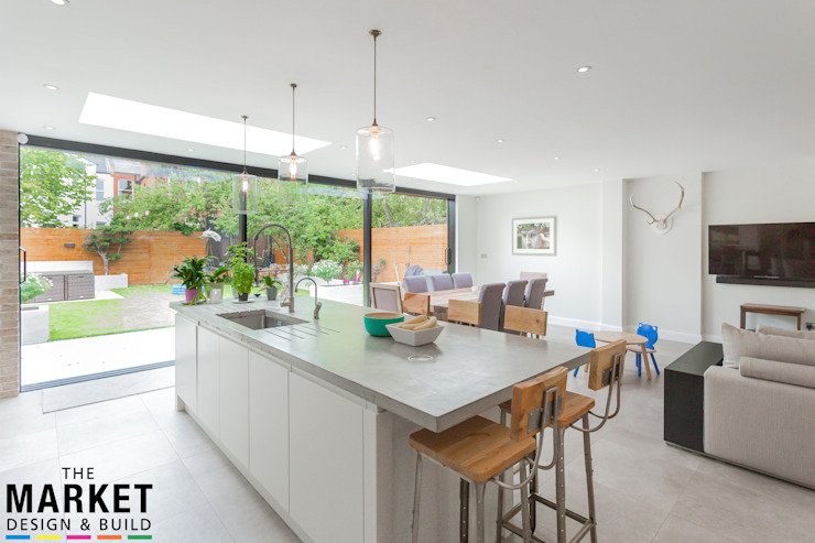 STUNNING NORTH LONDON HOME EXTENSION AND LOFT CONVERSION Comedores modernos de The Market Design & Build Moderno