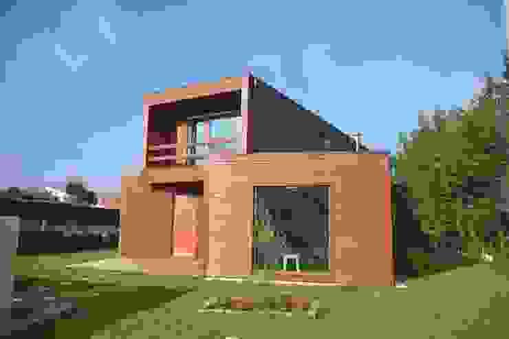 Casas de madera de estilo  por Rusticasa,
