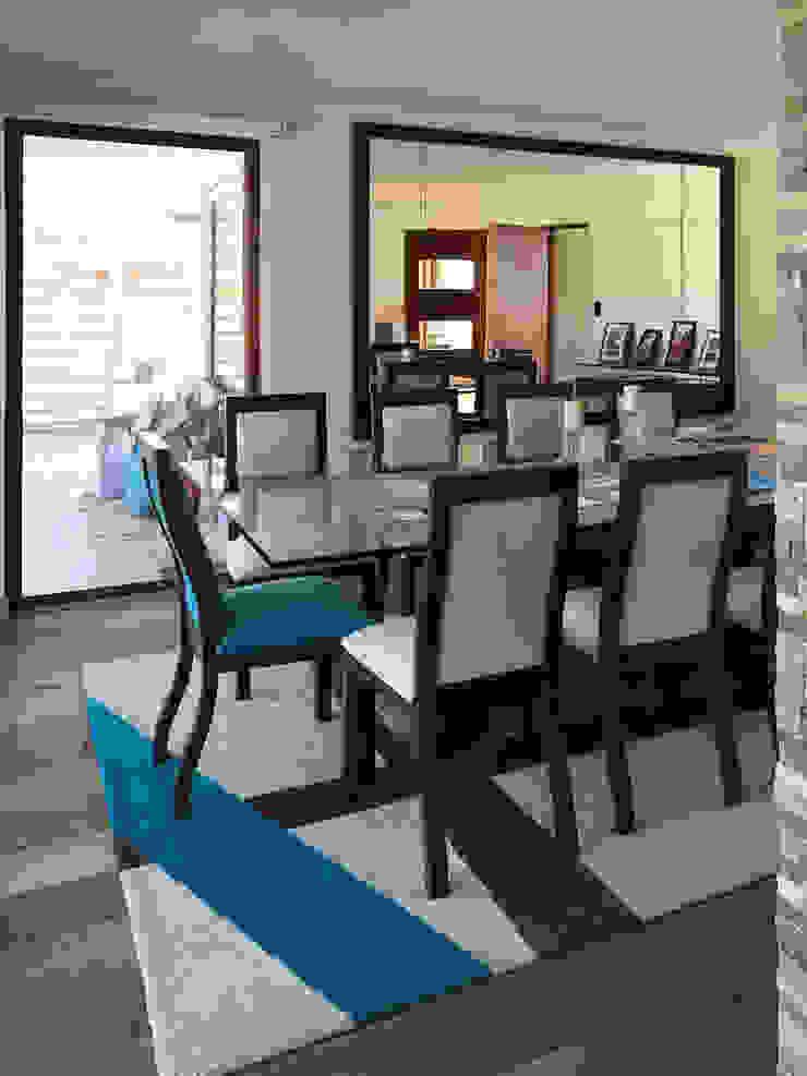 Casa El Golf Comedores de estilo moderno de AtelierStudio Moderno