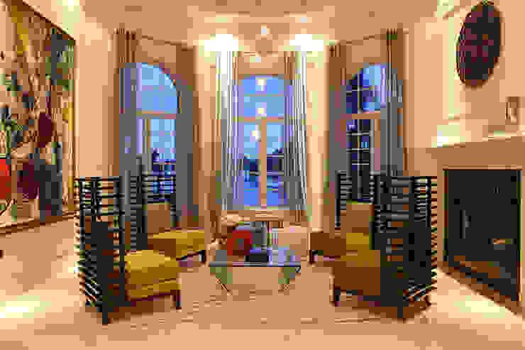 Salas de estilo moderno de Claudia Luján Moderno