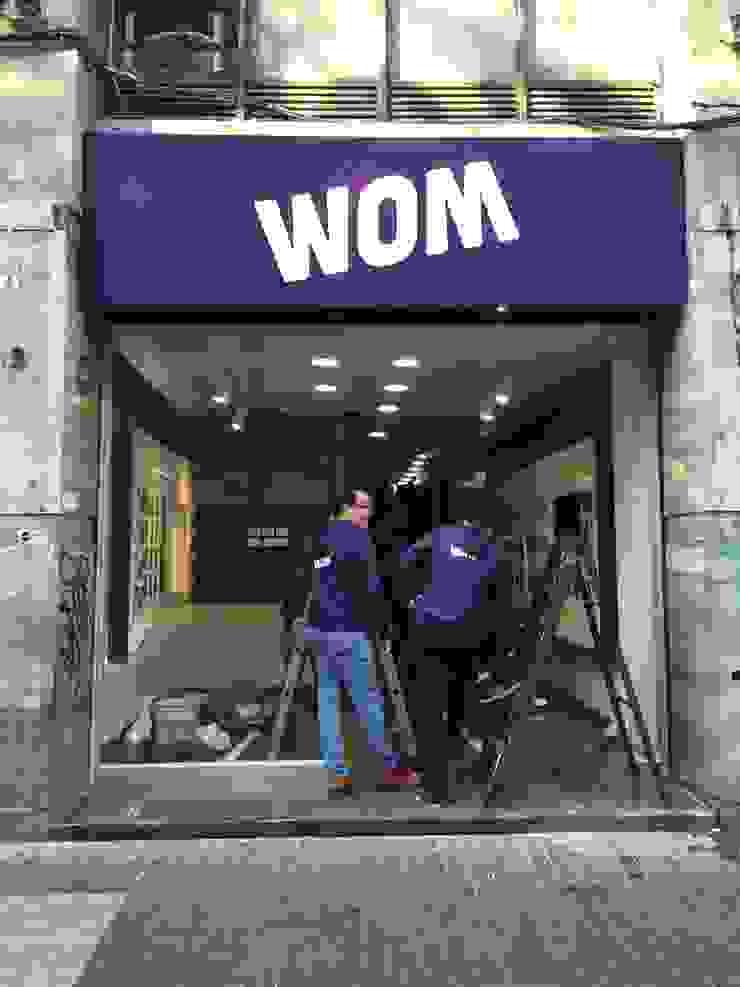 Habilitación sala ventas WOM <q>Puente</q> de Qarquitectura Moderno
