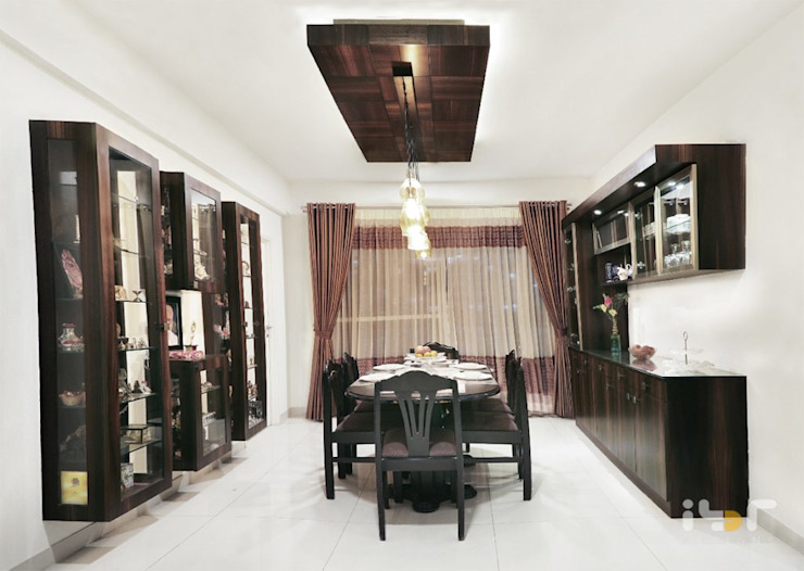 Dining room: modern  by Interiors by ranjani,Modern