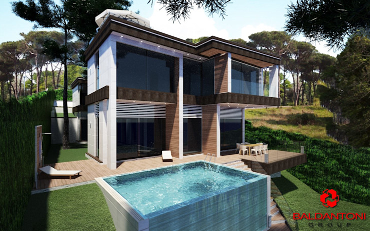 Vista della villa sul retro con piscina Baldantoni Group Case moderne