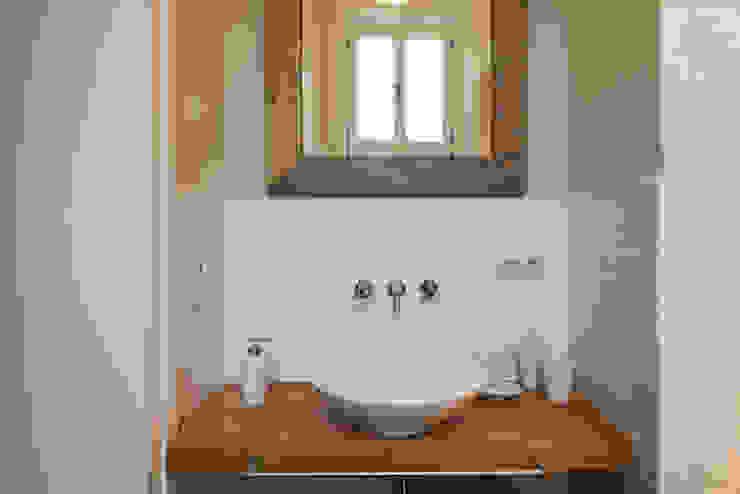 Rustic style bathroom by raumdeuter GbR Rustic