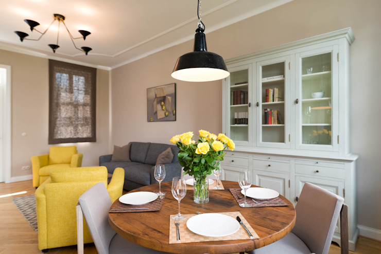 Rustic style dining room by raumdeuter GbR Rustic