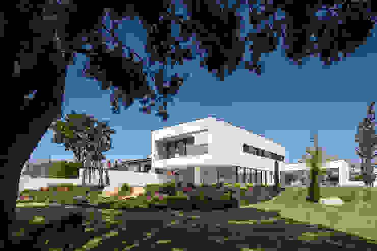 PERSPECTIVA EXTERIOR: Casas  por HUGO MONTE | ARQUITECTO,Minimalista Betão