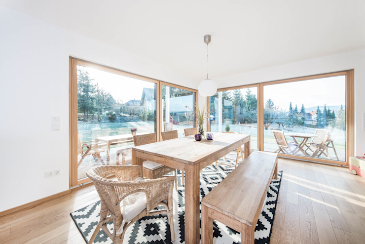 Eclectic style dining room by wir leben haus - Bauunternehmen in Bayern Eclectic Wood Wood effect