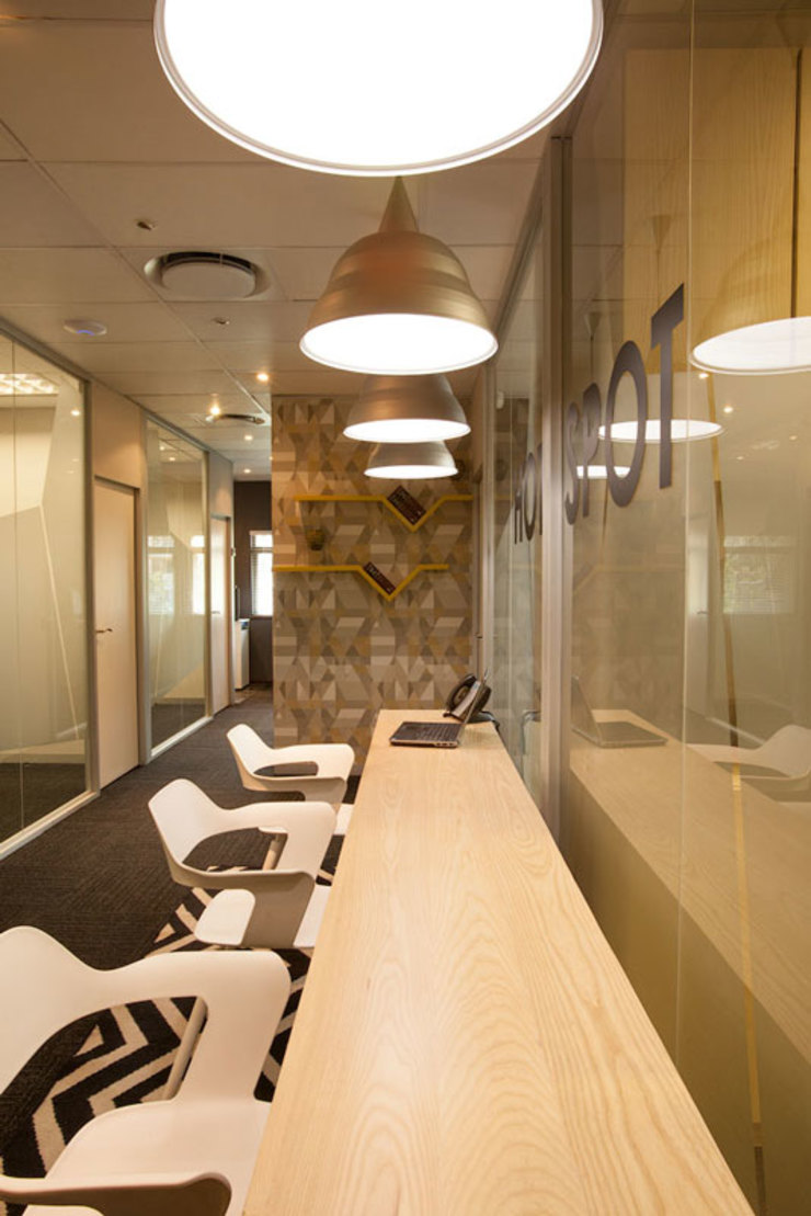 Modern office buildings by Redesign Interiors Modern