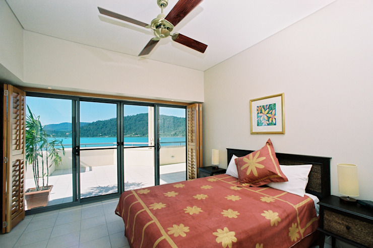 Bedroom Plantation Shutters Tropical style bedroom by TWO Australia Tropical