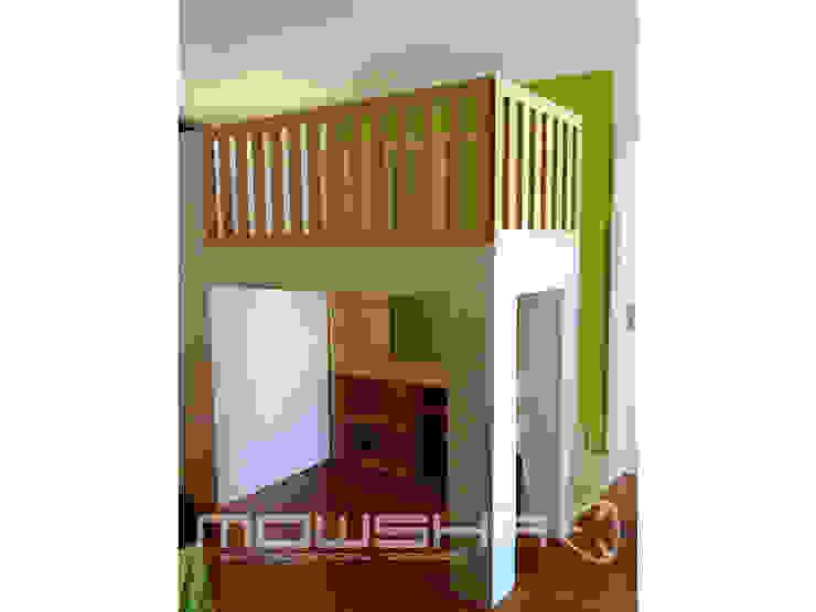 O espaço por baixo é arejado e iluminado para as brincadeiras. a parte posterior é composta por um roupeiro com divisões amovíveis. Mowsha tek Design Lda Berçários