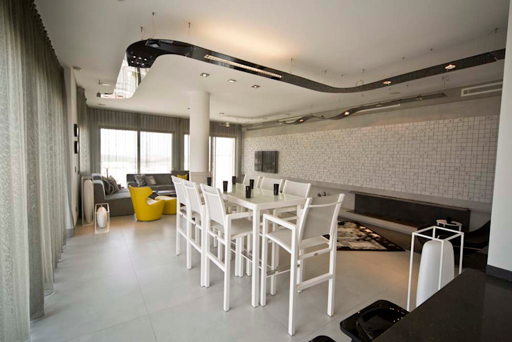 Private Roof Modern Dining Room by Nisreen Atari, Architects.Consultants Modern Tiles