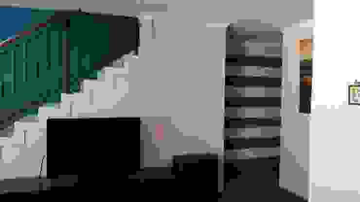 Feature wall Minimalist corridor, hallway & stairs by Indoni Interiors Minimalist Concrete