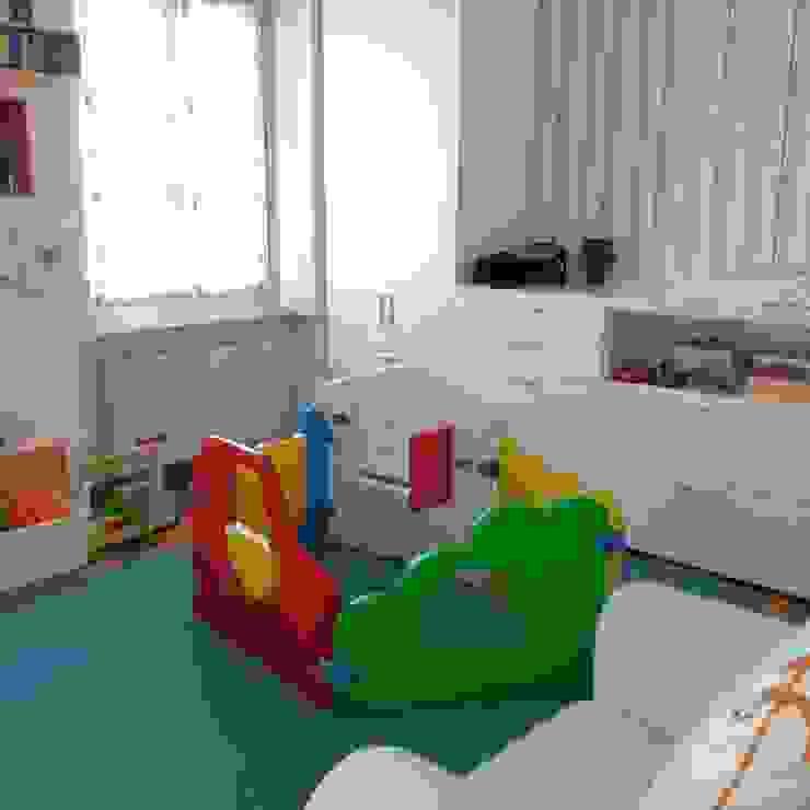 Appartamento A+M Stanza dei bambini moderna di ArchitetturaTerapia® Moderno