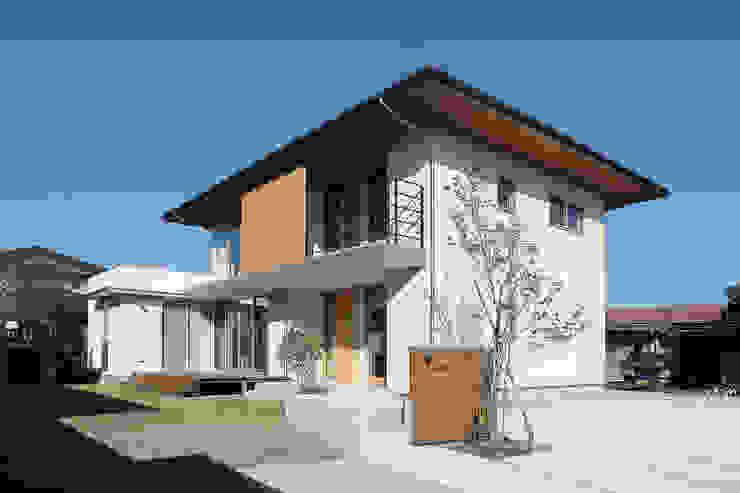 Casas de estilo ecléctico de TEKTON | テクトン建築設計事務所 Ecléctico