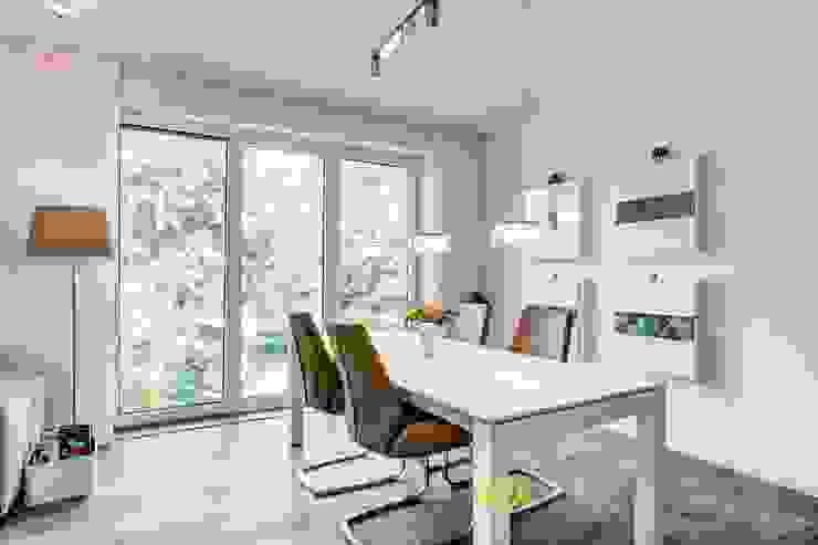 Modern dining room by LichtJa - Licht und Mehr GmbH Modern