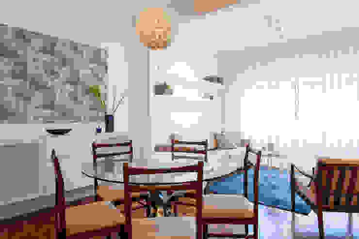 Comedor de estilo  por Traço Magenta - Design de Interiores