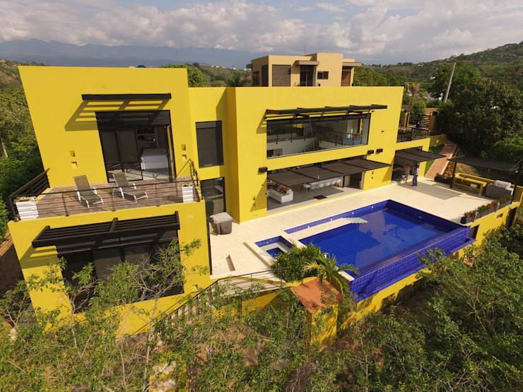 Houses by Arquitectos y Entorno S.A.S