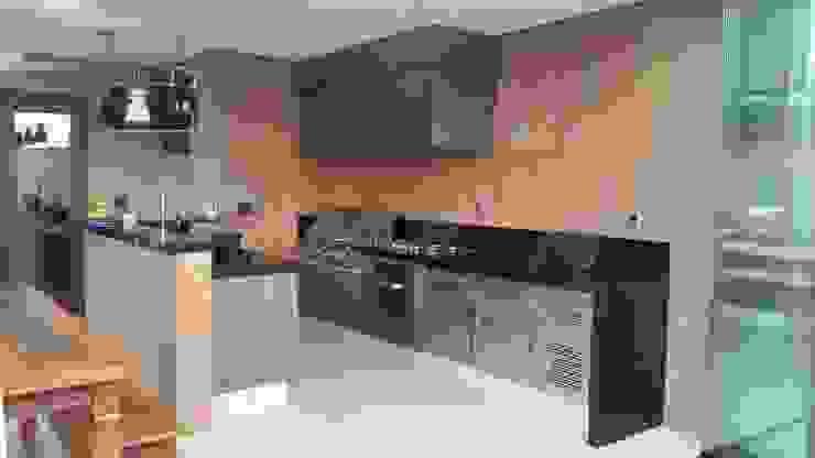 Patios & Decks by StudioCS Arquitetura, Rustic Granite