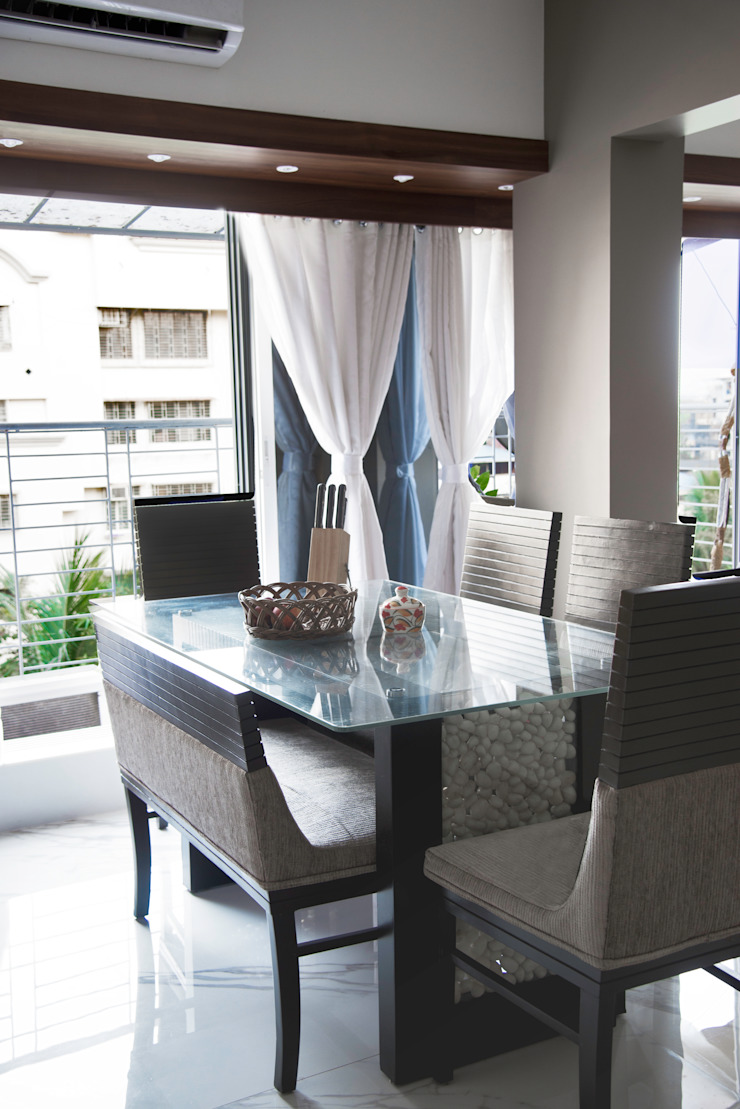 Dining area Minimalist dining room by The inside stories - by Minal Minimalist Plywood