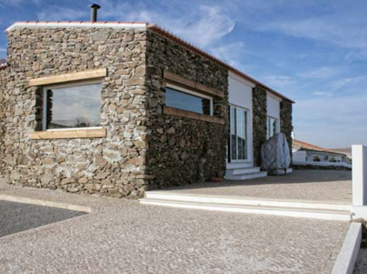 Monte do Guerreiro Rustic style house by Grupo Norma Rustic
