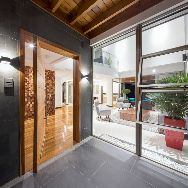 Modern style doors by J-M arquitectura Modern Wood Wood effect