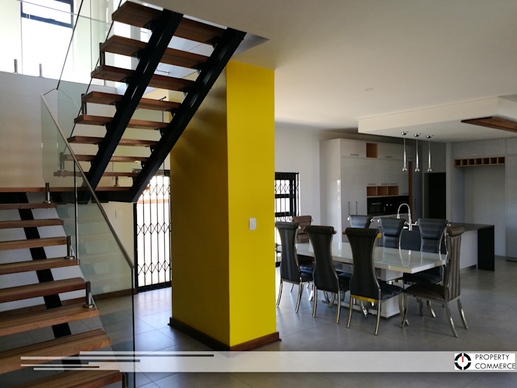 Exposed wooden staicase Modern dining room by Property Commerce Architects Modern