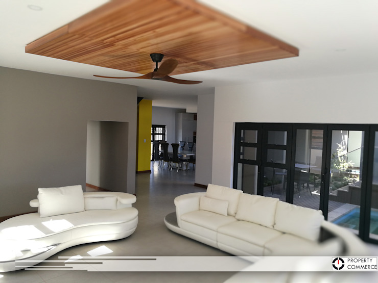 Living room Modern living room by Property Commerce Architects Modern