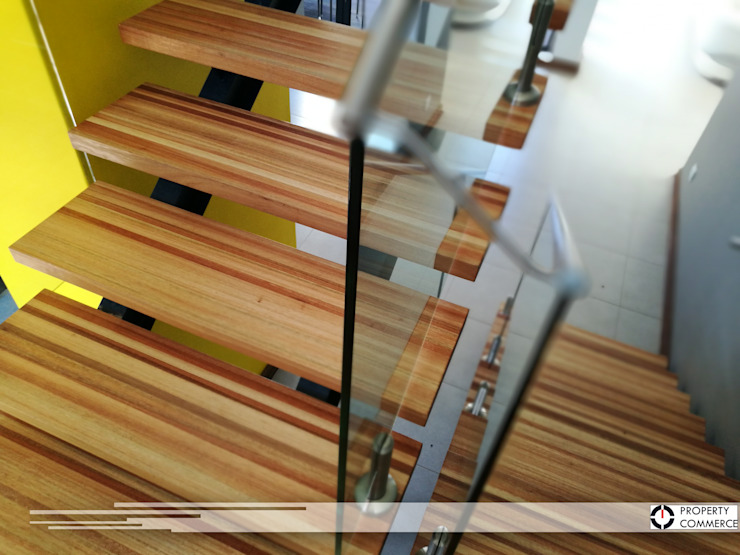 Saligna Wood stairs Modern Corridor, Hallway and Staircase by Property Commerce Architects Modern