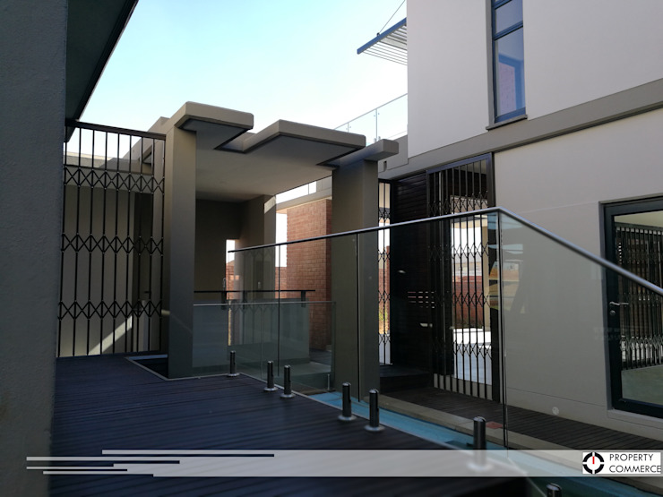 Internal courtyard view to external bar by Property Commerce Architects Modern