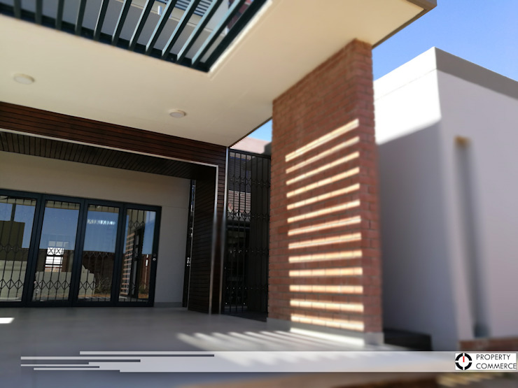 Outside patio by Property Commerce Architects Modern