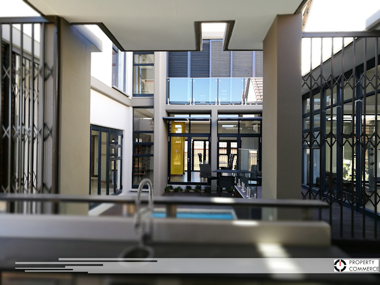 Internal courtyard view from bar by Property Commerce Architects Modern