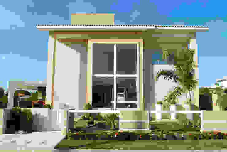 Casa com fachada marcante Bernal Projetos - Arquitetos em Salvador Casas familiares