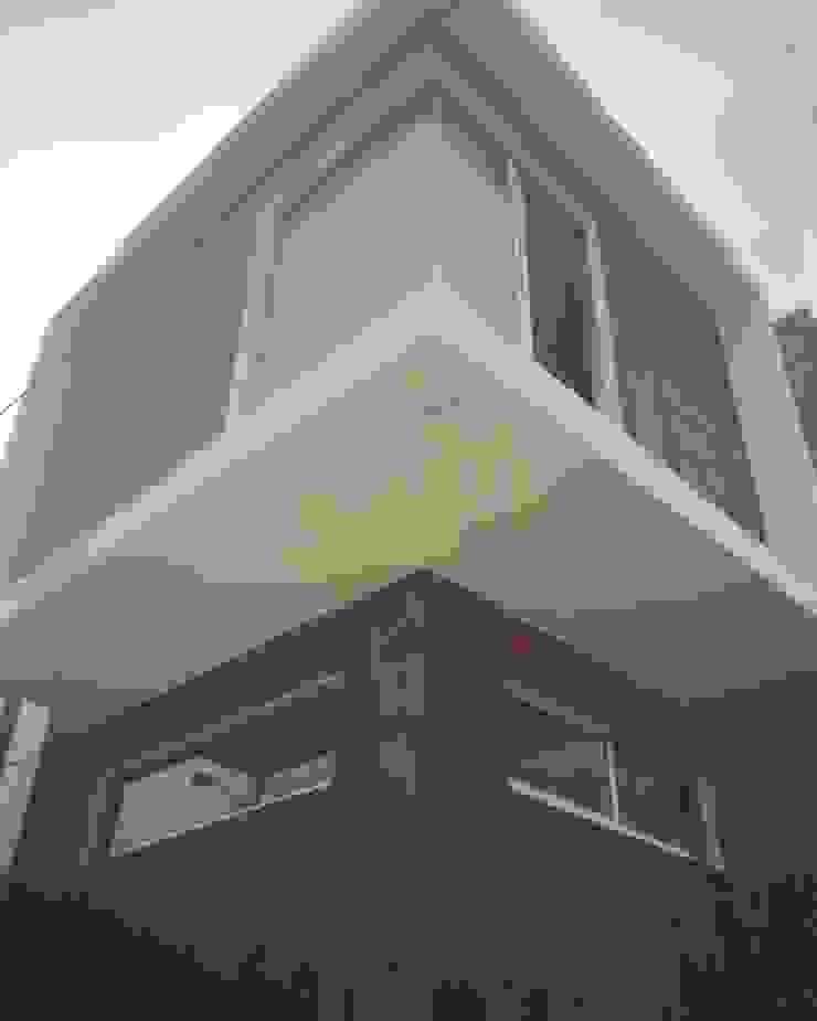 pequeño, comodo y funcional apartamento Ma&Co Casas minimalistas Concreto