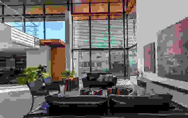 Volumetrias que espelham modernidade Salas de estar modernas por Ruschel Arquitetura e Urbanismo Moderno
