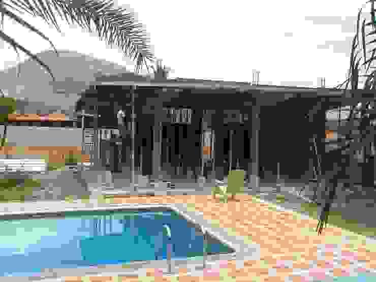 CASA VACACIONAL EN EL CARIBE Anexos de estilo tropical de Proyectonica Tropical
