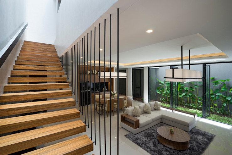 Corredores, halls e escadas tropicais por Simple Projects Architecture Tropical contraplacado