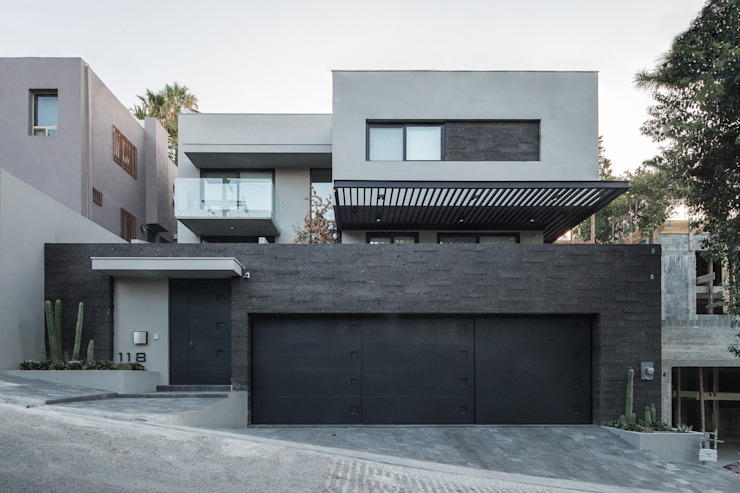 Houses by Rousseau Arquitectos,